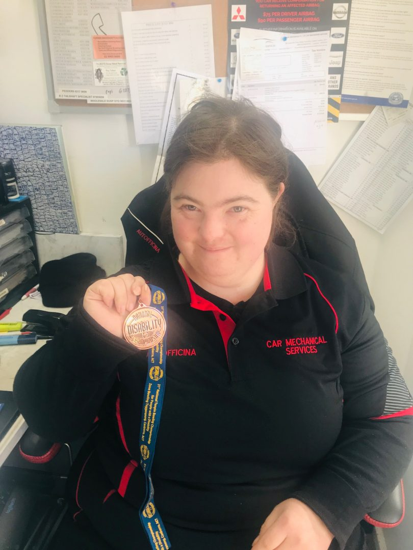 Naomi shows off her medal won for bowling