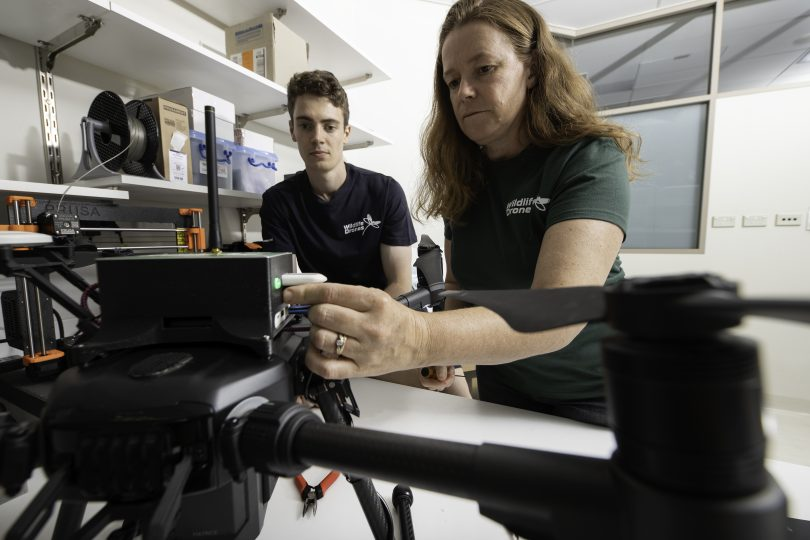 Dr Debbie Saunders and Liam Kennedy setting up a drone in a lab